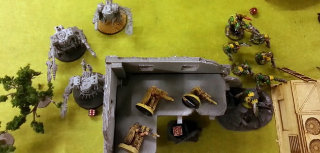 The Warboss and his squad of Nobs sprang through a gap in a wall