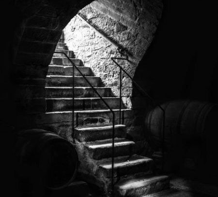 Dark stairs. What room's unimportant down here?